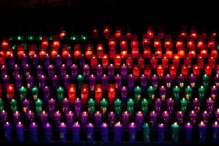 candles burning at montserrat cathedral in catalonia Stock Photo