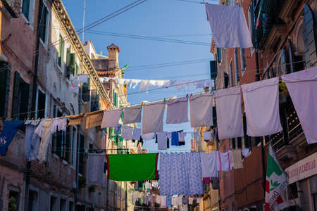 hanging woman: Linen in Venice streets Stock Photo