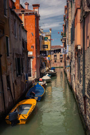 Venice canal with gondolas photo