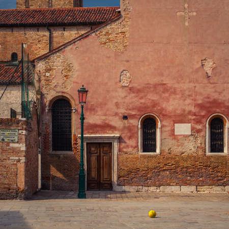 Orange ball on Venice street photo