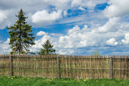 Rural landscape with countryside yard and fence Stock Photo