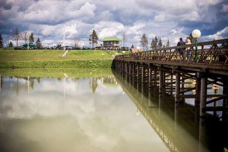 woden: Landscape with woden bridge across the river