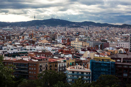 Barcelona city under cloudy sky overview