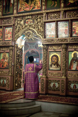 iconostasis: MOSCOW - MARCH 13: Orthodox liturgy with bishop Mercury in High Monastery of St Peter in Moscow on March 13, 2010 in Moscow
