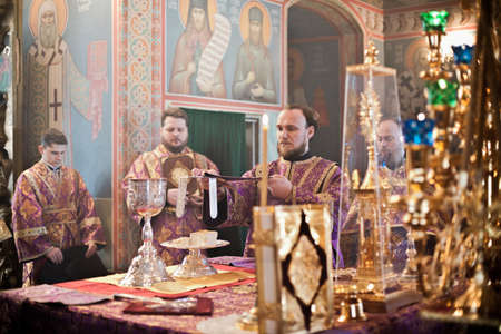 iconostasis: MOSCOW - MARCH 14: Orthodox liturgy with bishop Mercury in High Monastery of St Peter in Moscow on March 14, 2010 in Moscow Editorial