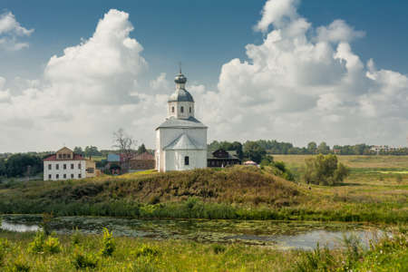 Ancient orthodox temple surrounded with beautiful flat nature Stock Photo