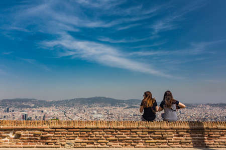 unidentified: Beautiful city landscape in Barcelona and unidentified girls in summer time
