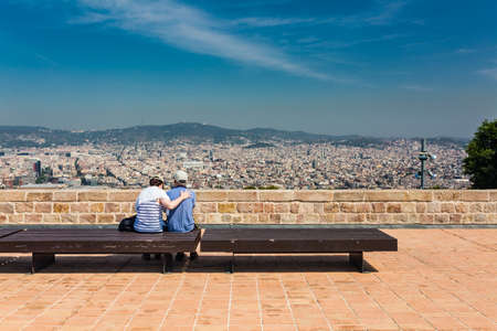 unidentified: Beautiful city landscape in Barcelona and unidentified couple in summer time Stock Photo
