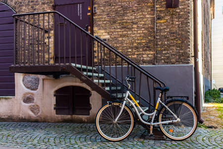 Classic Vintage Bicycle standing near house on street in Malmo, Sweden