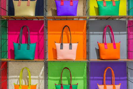 shelves: colorful hand bags on shelves Stock Photo