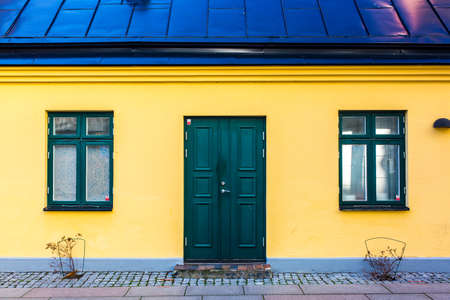 single dwelling: colorful house exterior, vintage windows in Malmo, Sweden