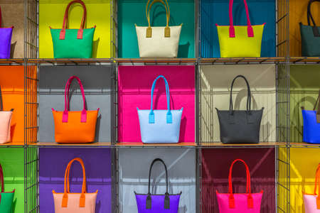 colorful hand bags on shelves Stock Photo