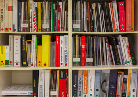 BARCELONA, SPAIN - OCTOBER 7, 2015: Bookshelves with variety of different colorful books and magazines