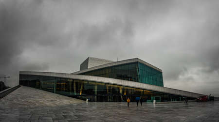 OSLO, NORWAY - OCTOBER 20, 2015: The Oslo Opera House in Norway. The angled exterior surfaces of the building are covered with white granite and make it appear to rise from the water.