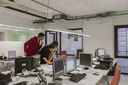 BARCELONA, SPAIN - OCTOBER 7,2015: Engineer men developing architecture project