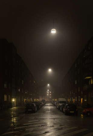 COPENHAGEN, DENMARK - NOVEMBER 6, 2015: Copenhagen street at night with cars