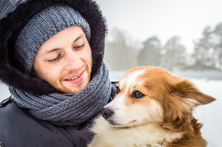 man lovingly looks at his dog. concept love for pets Stockfoto - 99683938