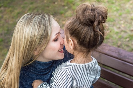portrait of young woman and little girl close-up. swish Foto de archivo