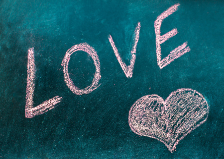 Word love is drawn in chalk. Valentine's Day