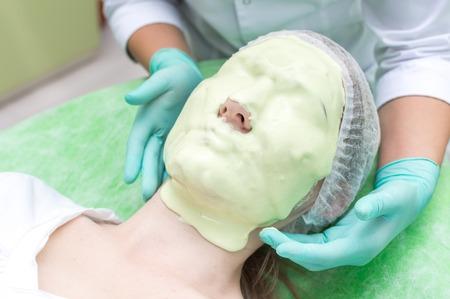 Beautician Applying Alginate Mask On Female Face Banco de Imagens
