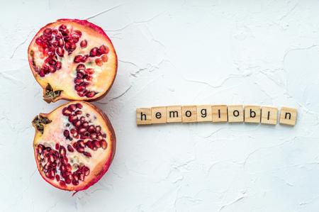 Cut pomegranate on a white background. Concept hemoglobin