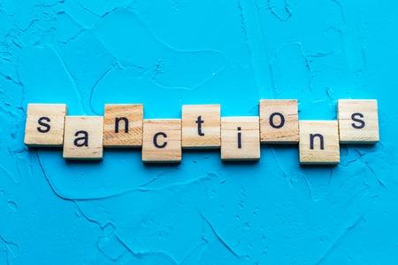 Inscription letters close up sanctions. Concept Horizontal photo Stock Photo