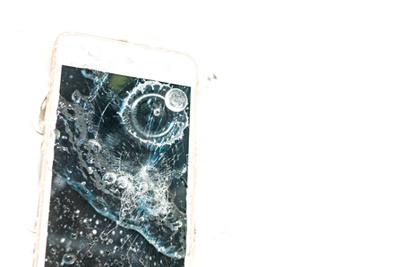 Phone dropped into the water. Broken smartphone. Close up