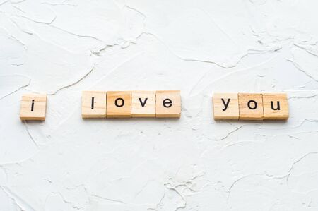 inscription i love you on white wooden background.concept