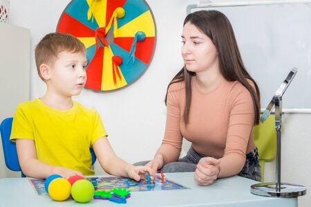 Young woman speech therapist is engaged in the office with a child Stock Photo