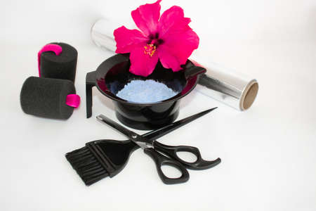 Tools for hair dye and hairdye white background.Barber set with hair dye, foil and brush, scissors and curlers. Set for coloring.