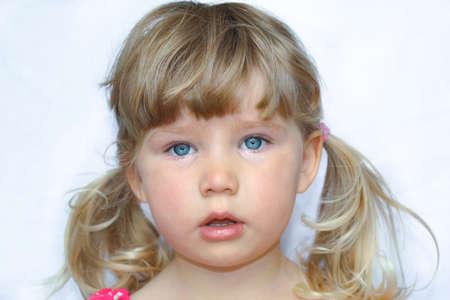 Blue eyed baby girl portrait