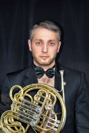 French hornist without shirt Фото со стока