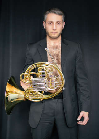 Man without shirt with a musical instrument Фото со стока