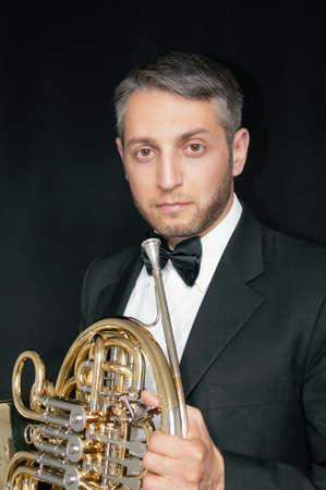 French hornist musician portrait Фото со стока