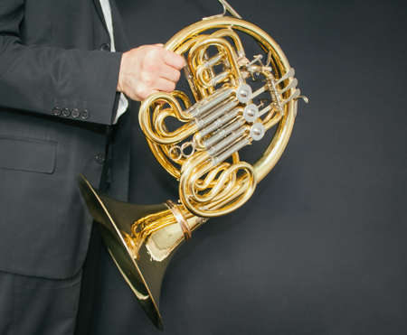 Man holding musical instrument french horn