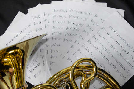 French horn and music sheets