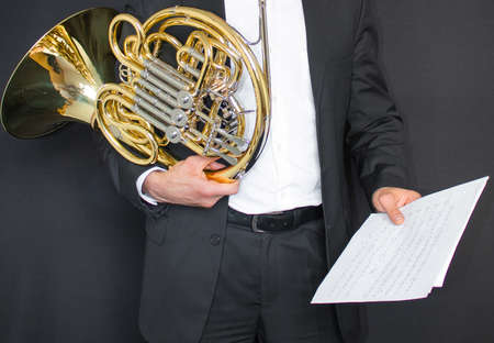 Man with a French horn