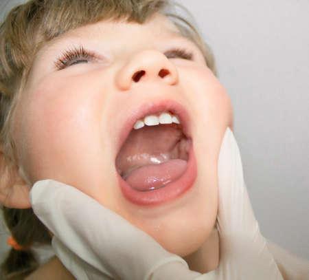 Kids mouth medical looking Фото со стока