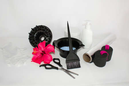 Hair color kit with flower and bottles