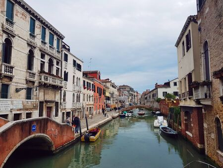 Venetian canal after the rain, ancient architecture of Italy