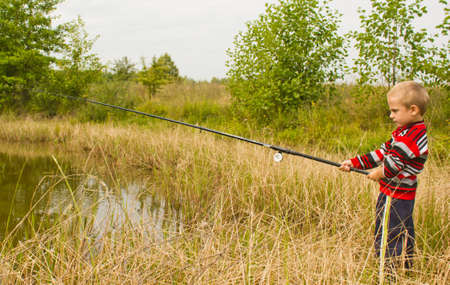 The little boy on fishing Stock Photo - 12758987
