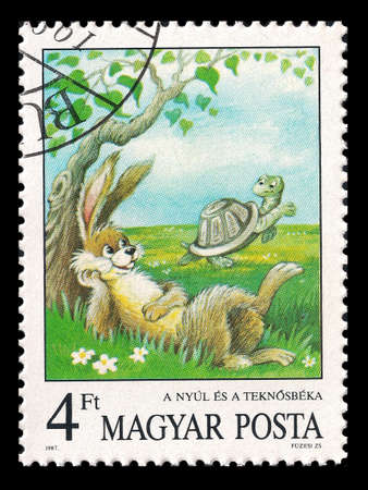 Slaked Magyar Posta postage stamp in 1987 with a rabbit and a turtle Stock Photo