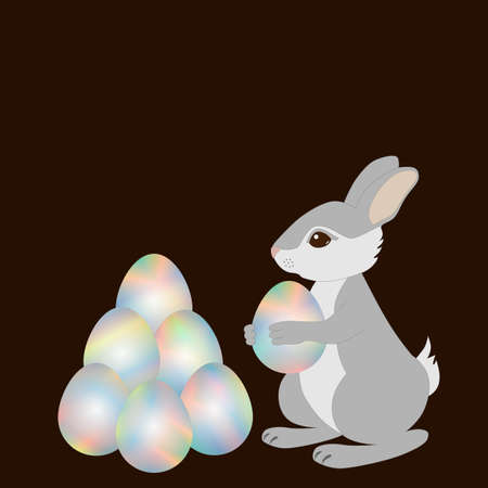 gray bunny holds in paws an Easter egg