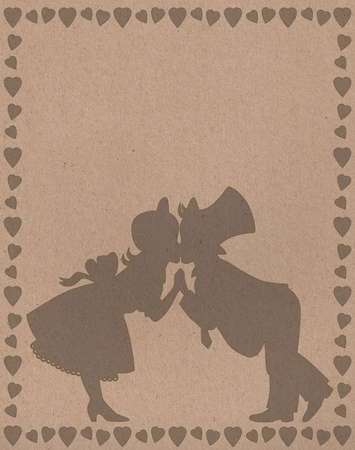 holidays for couples: dark silhouette of kissing a boy and a girl in a frame of hearts Stock Photo
