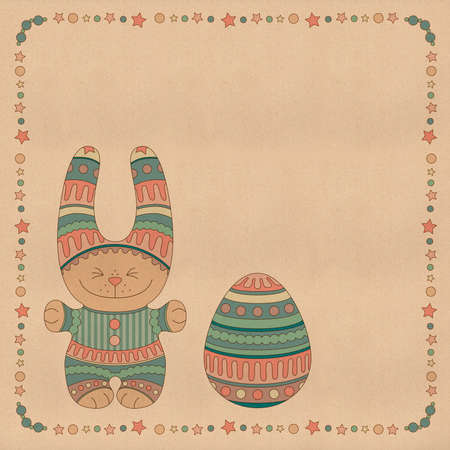 Ornamental bunny with a Easter Egg in a frame of stars and balls Stock Photo
