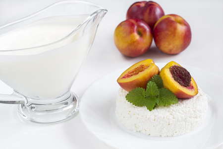 Ripe peaches with curd and yoghurt photo