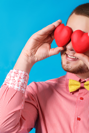 Valentine s day  Smiling man holding two hearts photo