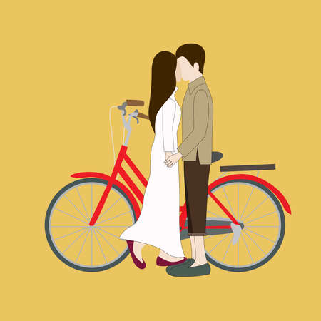 Young couple standing near a bicycle.
