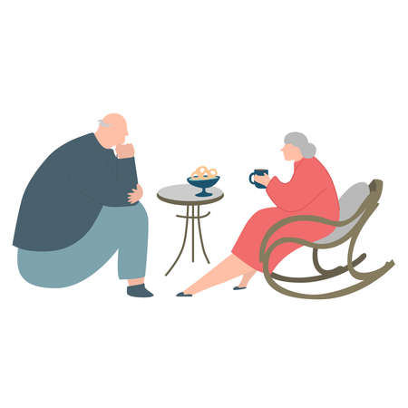 Young retired couple sitting drinking tea.