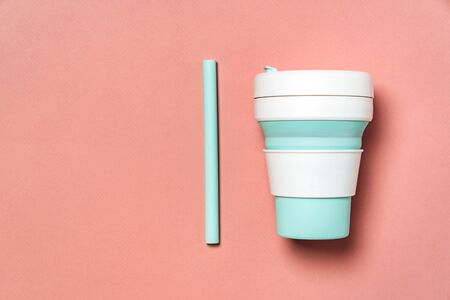 Flat lay composition with take away mint eco coffe cup on coral background with copy space for text. Stock fotó